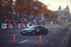 Automobile slalom and drift competitions in the city center, car on the road with cones. Kiev, Ukraine - October 22: automobile slalom and drift competitions in royalty free stock photos