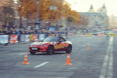 Automobile slalom and drift competitions in the city center, car on the road with cones. Kiev, Ukraine - October 22: automobile slalom and drift competitions in royalty free stock image