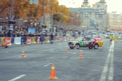 Automobile slalom and drift competitions in the city center, car on the road with cones. Kiev, Ukraine - October 22: automobile slalom and drift competitions in royalty free stock images