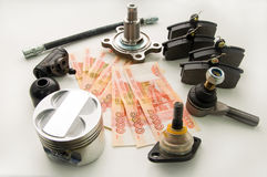 Automobile spare parts and money Stock Photography