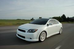 Automobile sportiva d'accelerazione Fotografia Stock