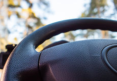 Automobile steering wheel blur bottom view close up