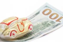 Automobile su cento dollari di fattura Immagine Stock Libera da Diritti