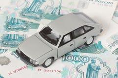Automobile su priorità bassa di soldi Immagini Stock