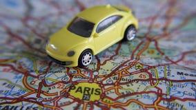 Automobile su una mappa Fotografia Stock