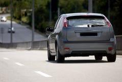 Automobile sulla strada Fotografia Stock