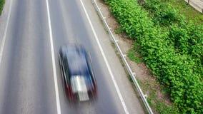 Automobile sulla strada con moto della sfuocatura Fotografia Stock Libera da Diritti