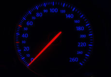 Automobile tachometer on blue Royalty Free Stock Photography