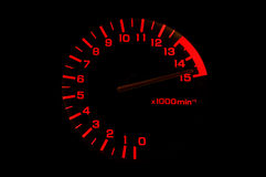 Automobile tachometer even faster. Automobile tachometer on black background even faster Royalty Free Stock Photography