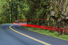 Automobile Tail Lights Streaking Around Smoky Mountain Curve royalty free stock photo