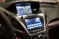Automobile Technology Package. Some of the features in the automotive technology package include the in-dash navigation system, an upgraded audio system, a voice stock photo