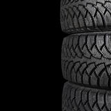 Automobile tire on black. The automobile tire on a black background Royalty Free Stock Photos