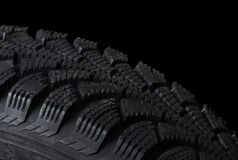 Automobile tire on black Stock Photos