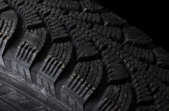 Automobile tire on black background Stock Images