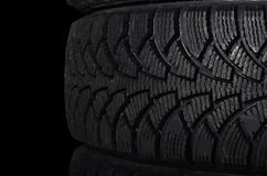 Automobile tire on black background Royalty Free Stock Photos