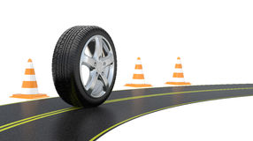 Automobile tire, road cone,  and long road Royalty Free Stock Image