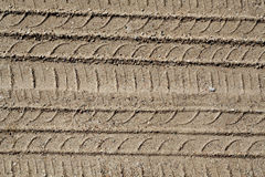Automobile tire tracks on sandy road. Royalty Free Stock Images