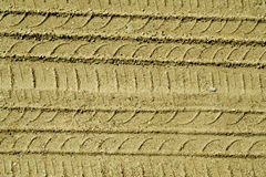 Automobile tire tracks on sandy road. Royalty Free Stock Photos