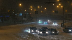 Automobile traffic is difficult due to bad weather and snowstorms. Bad weather conditions. Dangerous weather conditions for drivers: snowfall, blizzard. Snow stock video