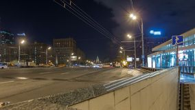 Automobile traffic on Kutuzov Avenue timelapse hyperlapse in Moscow. View from exit of underground crossing with reflections stock footage