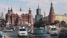 Automobile traffic moving along Moscow kremlin building, summer festival. Sunny warm day stock footage
