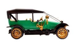 Automobile verde antica del modello di scala dell'accumulazione del giocattolo Fotografia Stock Libera da Diritti