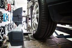 Automobile wheel alignment Stock Photography