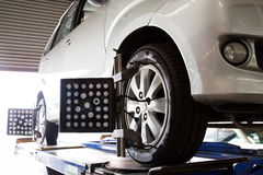Automobile wheel alignment Stock Images