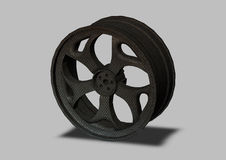 Automobile wheel on a gray background Royalty Free Stock Image