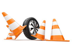 Automobile wheel has collided cones Royalty Free Stock Photography