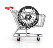 Automobile wheels and shopping cart. Stock Images