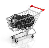 Automobile wheels and shopping cart. Stock Photo