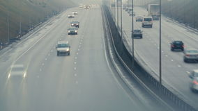 Automobiles cars drive on foggy city road. Dangerous driving conditions in winter season. stock video