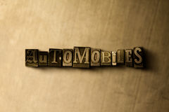 AUTOMOBILES - close-up of grungy vintage typeset word on metal backdrop Royalty Free Stock Photography