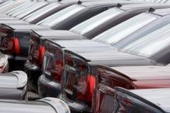 Automobiles de parc à matériau Images stock