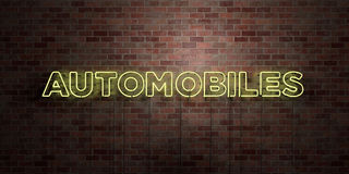 AUTOMOBILES - fluorescent Neon tube Sign on brickwork - Front view - 3D rendered royalty free stock picture. Can be used for online banner ads and direct Stock Photography