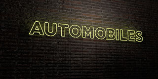 AUTOMOBILES -Realistic Neon Sign on Brick Wall background - 3D rendered royalty free stock image Royalty Free Stock Photography