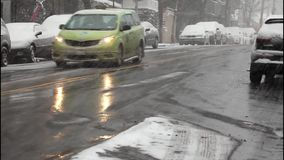 Automobiles in a snowstorm. BRONX, NEW YORK -JANUARY 7:  Automobiles in a snowstorm.  Taken January 7, 2017 in New York stock footage