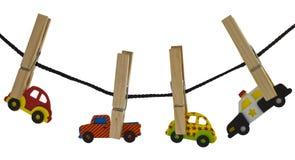 Automobiles sur une corde à linge Image stock