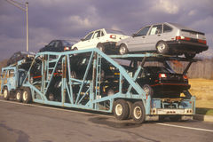 Automobiles on transport truck. Automobile transport truck hauling cars Stock Image