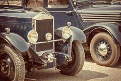 Automobili antiche, processo d'annata immagini stock