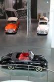 Automobili d'annata nere ed arancio bianche di Audi Immagini Stock