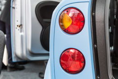 Automobili dei fanali posteriori con le porte aperte Fotografia Stock