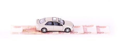 Automobili di modello sul modo di soldi Immagine Stock
