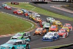 Automobili di riserva di corsa variopinte Fotografia Stock