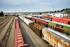 Automobili di scatola dell'iarda del treno di Seattle Interbay che aspettano un carico Immagine Stock