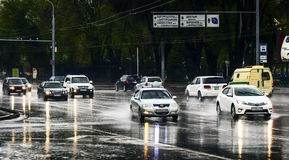 Automobili e pioggia Immagine Stock