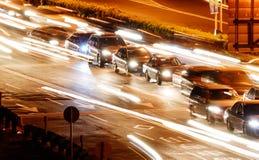 Automobili ed indicatore luminoso immagini stock libere da diritti