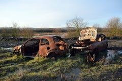 Automobili fuori bruciate rubate Immagini Stock