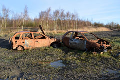 Automobili fuori bruciate rubate Fotografia Stock
